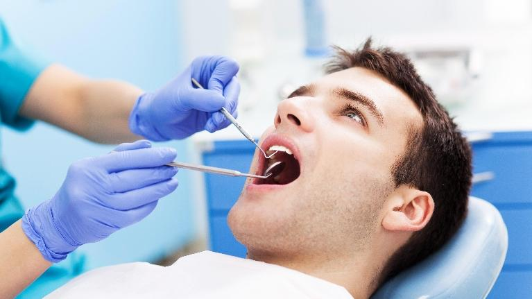 Man Getting Dental Exam | Alpharetta Creek Restorative Dentistry