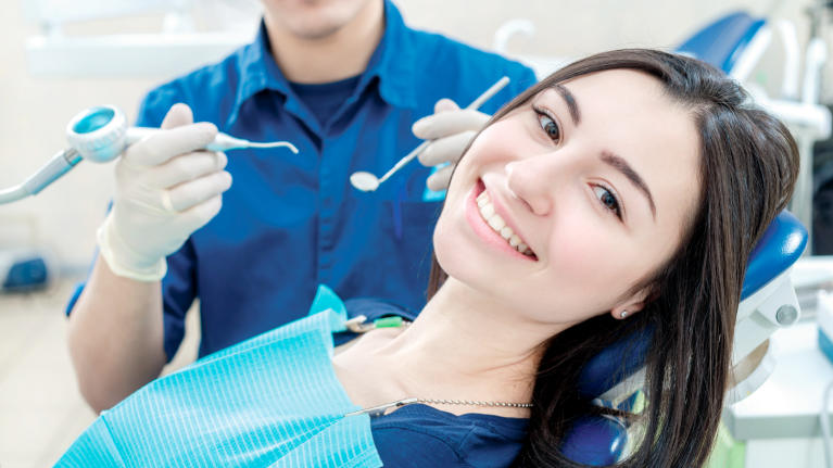 A Woman Smiles In The Dental Chair | Alpharetta, GA Dentist