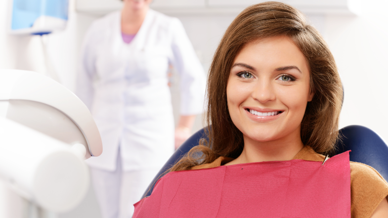 A Woman Sits In The Dental Chair | Alpharetta GA Dentist