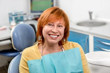 woman smiling in dental chair after root canal